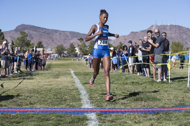 Alexis Gourrier from Centennial High School finishes first during the women's junior-s ...