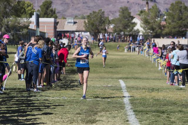 Olivia Weston runs towards the finish line during the women's junior-senior race at Fo ...