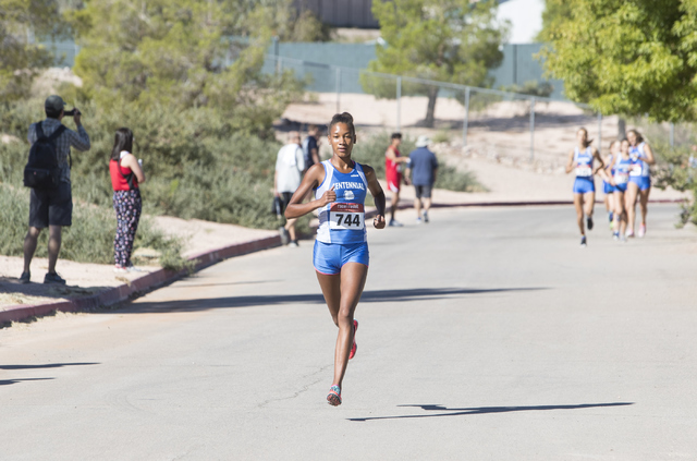 Alexis Gourrier from Centennial High School keeps pace during the women's junior-senio ...