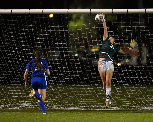 Palo Verde goalkeeper Kailee Barnhard blocks a shot from Reno's Shelby Clayton during ...