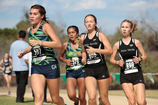 Green Valley's cross country runner Mia Smith (597) leads a small group of runners in ...