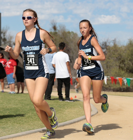 Foothill High School cross country team members Erica Schulz (541) and Erica Williams (545) ...