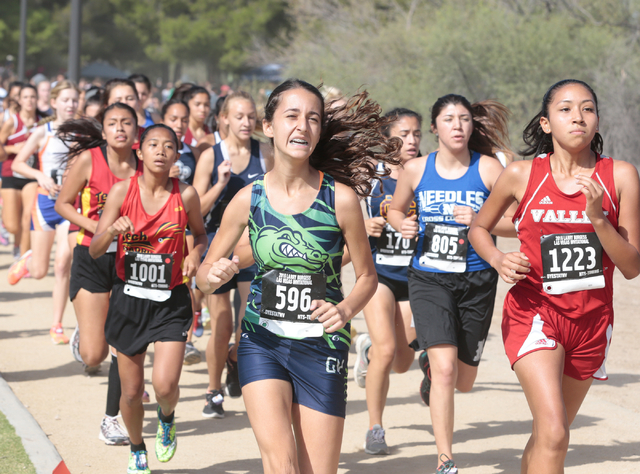 Green Valley's cross country runner Jennifer Sleman (596), and Valley's Lorraine ...