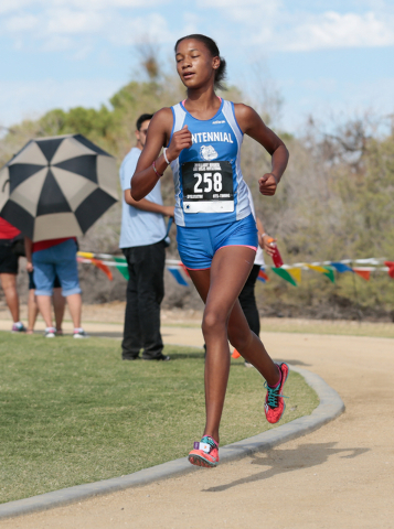 Centennial High School cross country runner Alexis Gourrier (258) is shown leading the varsi ...