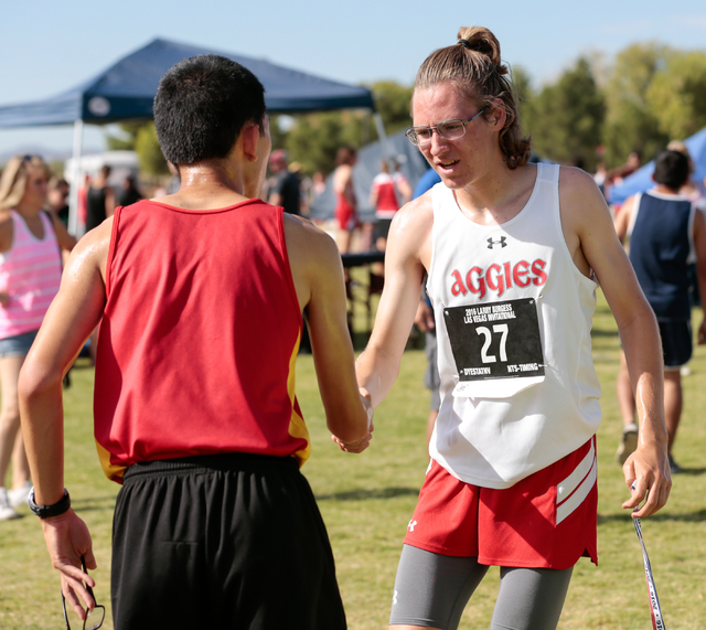 Arbor View junior and cross country runner Ian Jackson (27), right, congratulates another r ...