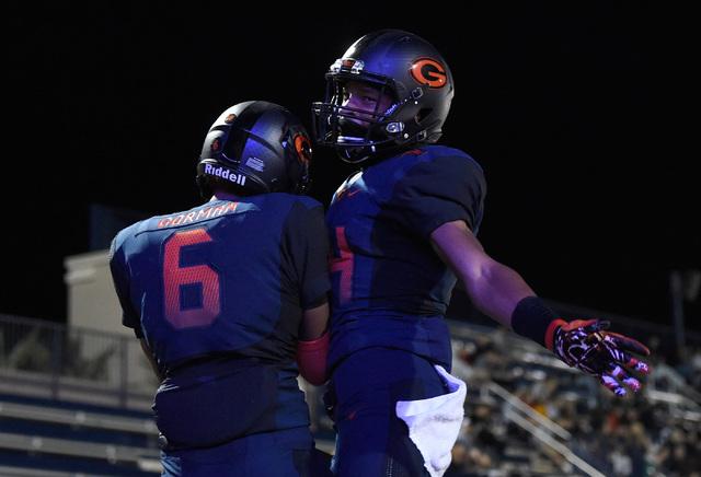 Bishop Gorman's Austin Arnold (6) and Dorian Thompson-Robinson celebrate a touchdown a ...