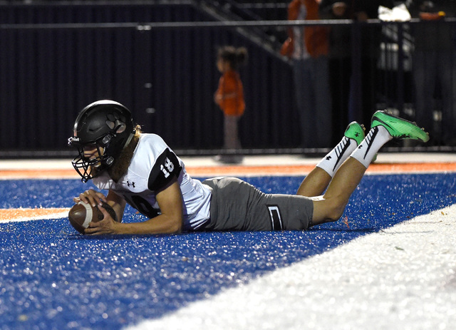Palo Verde punter Kyle Cole drops on the ball in the end zone causing a safety during the fi ...