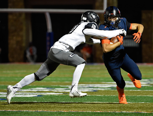Bishop Gorman's Biaggio Ali Walsh (7) carries the ball for against Palo Verde's ...