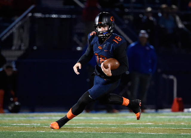 Bishop Gorman quarterback Tate Martell runs with the ball against Palo Verde during the firs ...