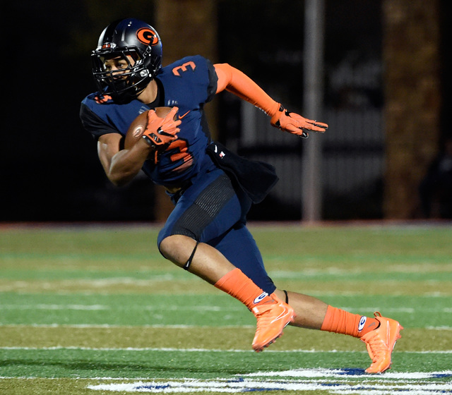 Bishop Gorman's Jalen Nailor carries against Palo Verde during the first half of a hig ...