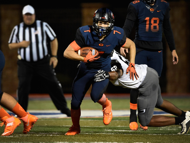 Bishop Gorman's Biaggio Ali Walsh (7) carries the ball against Palo Verde during the f ...