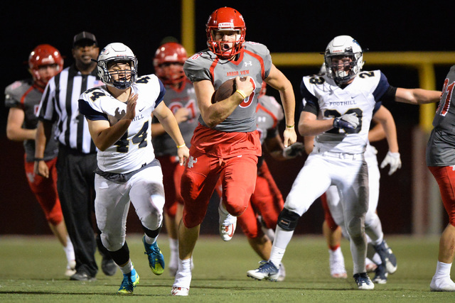 Arbor View quarterback Hayden Bollinger (18) runs the football during the Arbor View High Sc ...