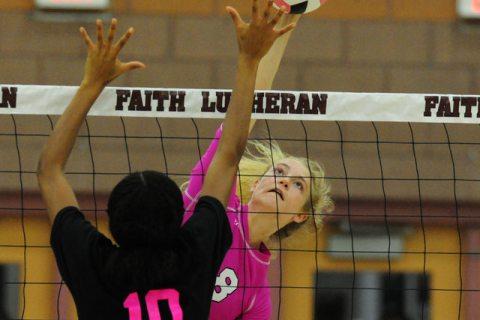 Faith Lutheran's Bryanna Neagle (8) kills the ball against Palo Verde during their pre ...