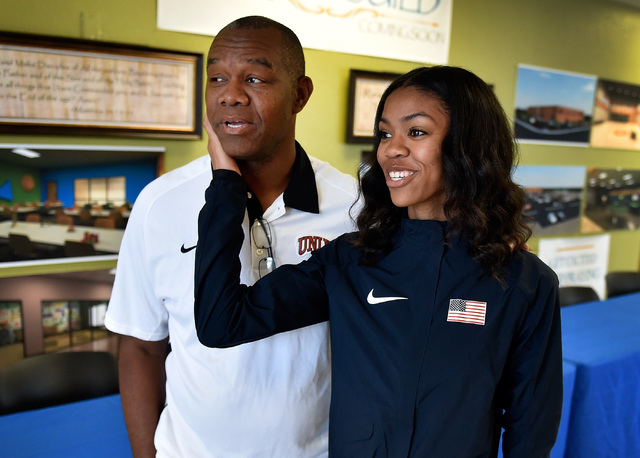 Bishop Gorman high jumper Vashti Cunningham, right, looks up to her father, former UNLV and ...
