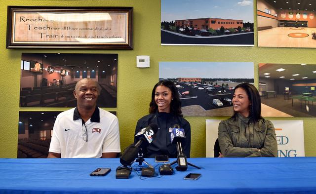 Bishop Gorman high jumper Vashti Cunningham, sits between her father, Randall Cunningham, le ...