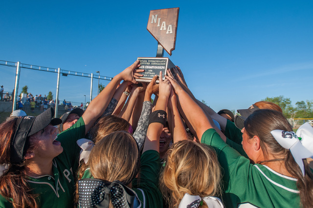 Palo Verde players hold up the state championship trophy after defeating Reed 12-8 Saturday ...