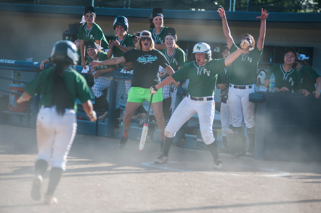 Palo Verde's Melissa Lacro runs through dust to her dugout after scoring against Reed ...