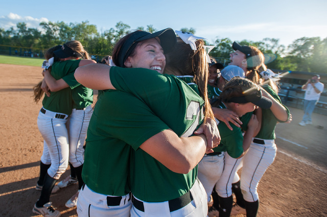 Palo Verde's Kelsea Sweeney, right, and Rachel Williams hug after their team defeated ...