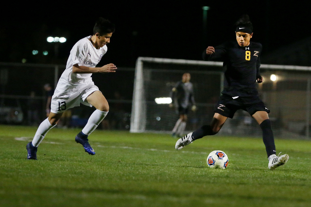 Durango's Erick Martinez Rodriguez (8) kicks the ball against Coronado at the Bettye W ...