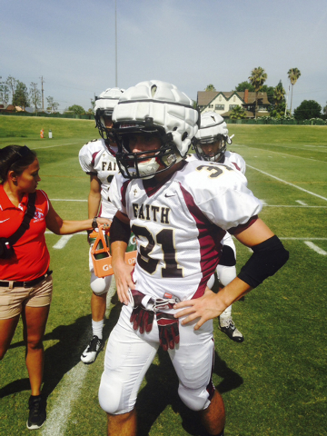 Faith Lutheran safety Tyler Mahan takes a break during the Fresno State football camp, while ...