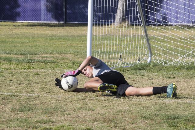 Paolo Sarnataro (23) dives for a ball during soccer practice at Durango High School in Las V ...
