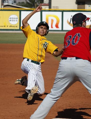 Rancho's David Camberos slides safely into third base as Coronado's Caden Spilsb ...