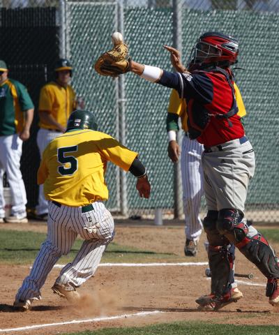 Rancho's David Modler, left, sneaks past Coronado catcher Nicco Festa on Tuesday. The ...