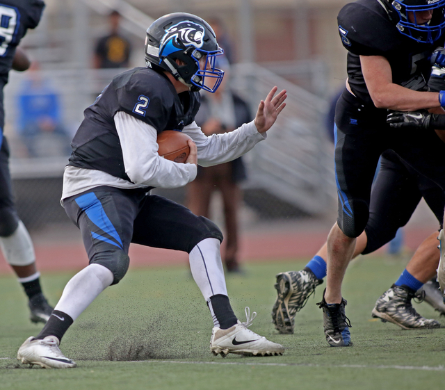 Pahranagat Valley's Quarterback Tabor Maxwell (2), runs with the ball during the class ...