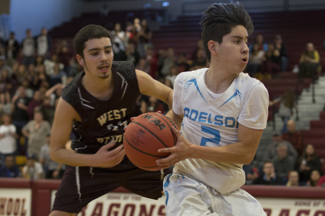 Adelson junior Ben Elharrar take the ball up the court during the 2A boys state semifinal ga ...