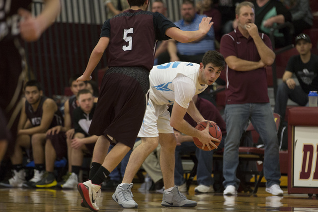 Adelson senior Jake Buchman looks for a teammate to pass to during the 2A boys state semifin ...