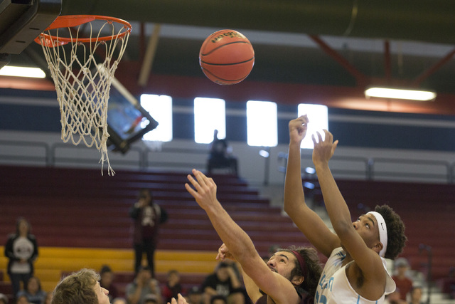 Adelson junior Miles Hagan goes up for a basket during the 2A boys state semifinal game at D ...