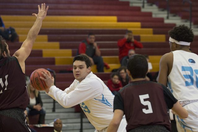 Adelson senior Brandon Pappas looks for a teammate to pass to during the 2A boys state semif ...