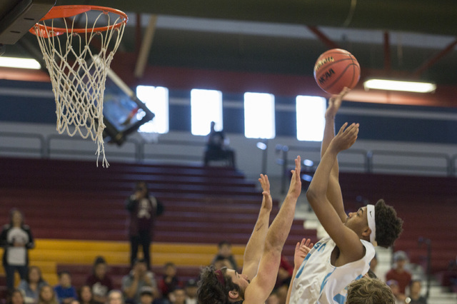 Adelson junior Miles Hagan goes up for a basket during the 2A boys state semifinal game agai ...
