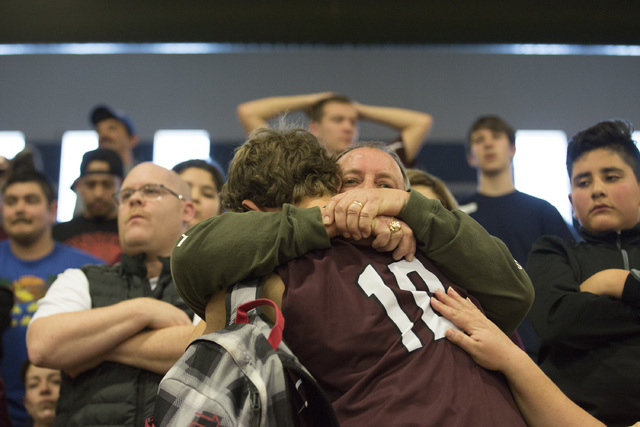 West Wendover senior Braden Price has an emotional moment after loosing to Adelson in overti ...
