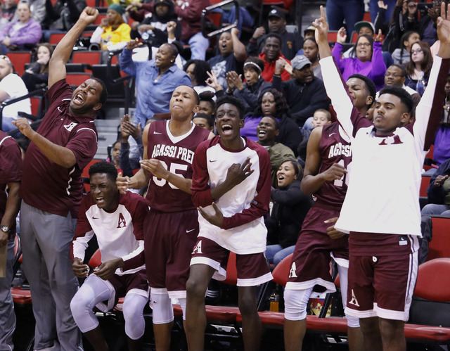 Agassi Prep's players and coaches react during the second half of a Class 2A boys stat ...