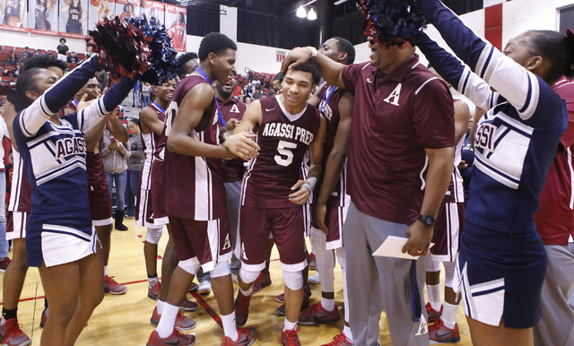 Agassi Prep's Allen Merritt (5) is cheered by teammates and coaches as he accept a med ...