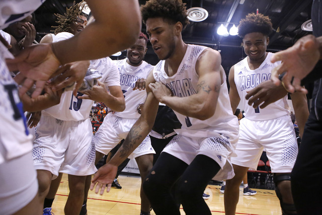 Cheyenne's Marcus Greer (3) dances as his teammates cheer him on after winning a Class ...