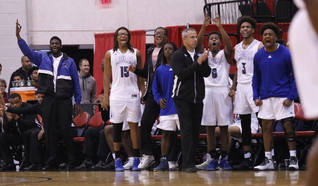 Desert Pines players react during the first half of a Class 3A boys state final championship ...