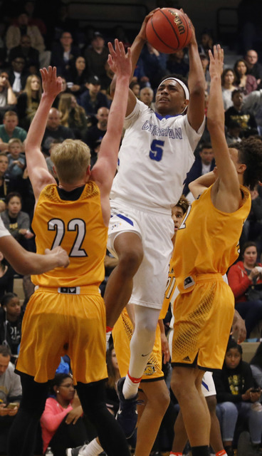 Bishop Gorman's Chuck O'Bannon (5) shoots during the second half of a Class 4A S ...
