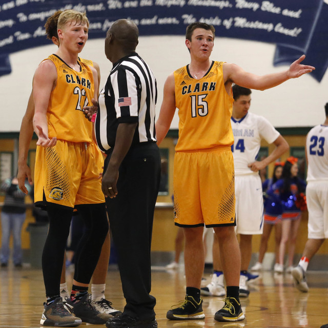Clark's Trey Woodbury (22) and Clark's James Bridges (15) speaks with the refere ...