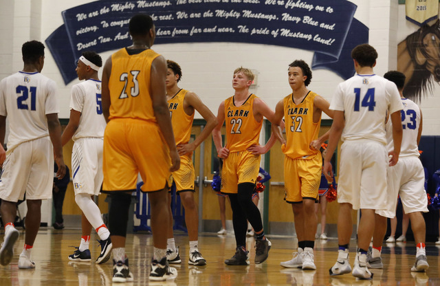 Clark players react during the second half of a Class 4A Sunset Region championship boys bas ...
