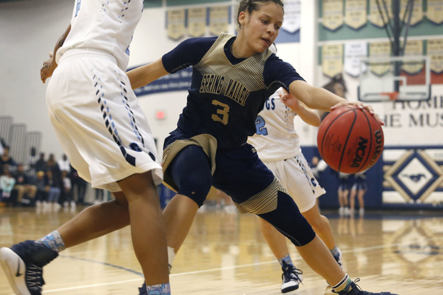 Spring Valley's Essence Booker (3) recovers a loose ball during the first half of a Cl ...