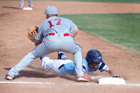 Foothill's Daniel Hauck slides safely into third base as Liberty's Josh McCollum ...