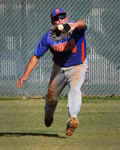Bishop Gorman's Brandon Wulff grabs a fly ball against Cimarron-Memorial on Monday. Go ...