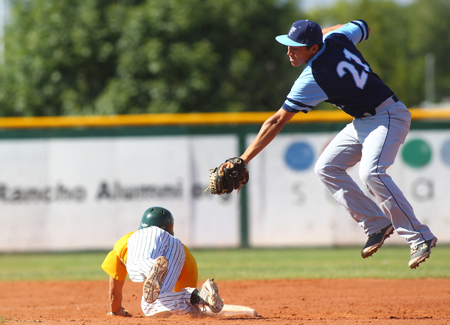 Rancho's Braulio Santiaguin slides under the tag of Foothill shortstop Tyler Van Stone ...
