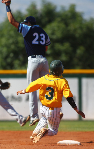 Rancho's Bryce Harrell (3) steals second base as Foothill's Nick Cardinale (23) ...