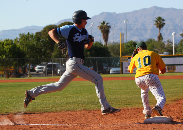 Foothill's Jack Fredericksen, left, runs to first base as Rancho's Josh Mill (10 ...