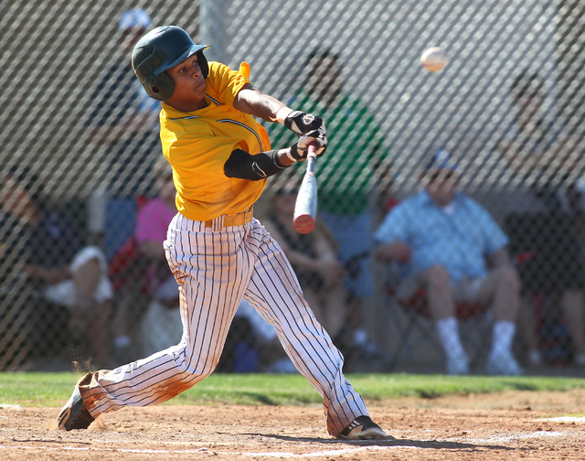 Rancho's Bryce Harrell drives a single to right during the second inning Friday. Harre ...