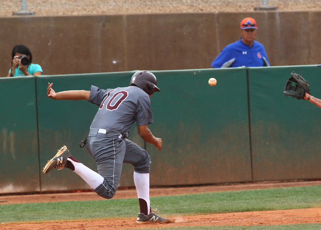 Cimarron-Memorial's Luis Flores (10) is caught in a run down between home plate and th ...