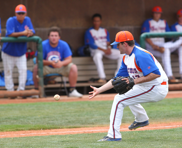 Bishop Gorman pitcher Bronson Bowe (13) fields a bunt while playing in the third inning agai ...